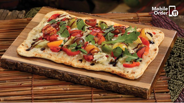 There is a picture of a flatbread pizza with tomatoes & basil, as well as a balsamic drizzle. Click the image to check out the Digital Product Analyst page.